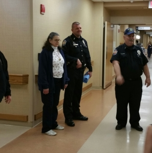 Pictured from left, Chris Coy, Southport Police Chief Thomas Vaughn and Chaplain John Coy deliver gifts at Franciscan St. Francis Health on Christmas Day, 2015.
